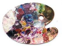 La paleta de los artistas con colores se mezcla sobre el fondo blanco Fotografía de archivo libre de regalías