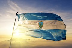 La Pampa province of Argentina flag textile cloth fabric waving on the top sunrise mist fog. Beautiful royalty free stock photos
