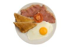 La pancetta affumicata, l'uovo, il pane tostato ed il pomodoro hanno fritto la prima colazione Fotografie Stock Libere da Diritti
