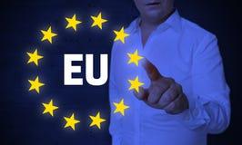 La pantalla táctil de la UE es actuada por concepto del hombre Foto de archivo libre de regalías