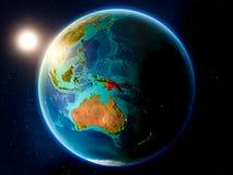 La Papouasie-Nouvelle-Guinée avec le coucher du soleil de l'espace photographie stock