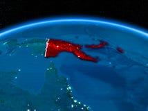 La Papouasie-Nouvelle-Guinée de l'espace la nuit Photographie stock libre de droits