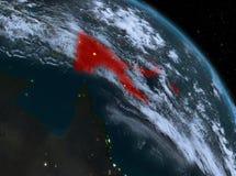 La Papuasia Nuova Guinea alla notte dall'orbita Immagine Stock