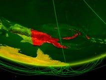 La Papuasia Nuova Guinea sul modello verde di pianeta Terra con la rete che rappresenta era digitale, viaggio e comunicazione ill illustrazione di stock