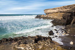 La Pared beach on Fuerteventura west coast. La Pared volcanic beach on Fuerteventura west coast, Canary Islands, Spain, with eroded landscape and black sand Royalty Free Stock Image