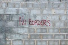 La pared con la inscripción ningunas fronteras Imagen de archivo