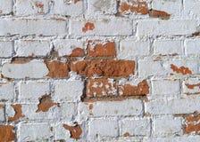 La pared de ladrillo vieja se hace de ladrillos rojos imagenes de archivo