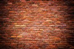 La pared de piedra del ladrillo del rojo bloquea el fondo para el diseño Imágenes de archivo libres de regalías