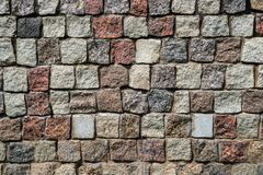 La pared del granito cuadrado empiedra el fondo foto de archivo