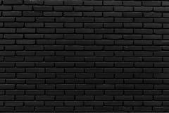 La pared grande negra por el ladrillo Fotos de archivo