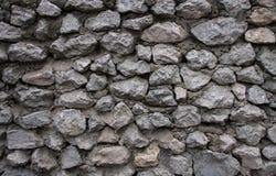 La pared hecha de piedras y del cemento grises Fotografía de archivo
