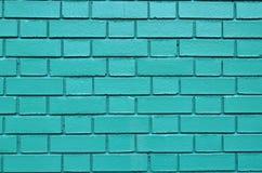 La pared verde de la pintura de la albañilería del fondo texturizada coloreó el ladrillo de los ladrillos Imagen de archivo