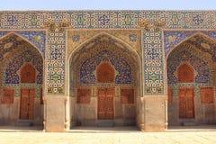 La parete della moschea dello scià (imam Mosque) sul quadrato di Naqsh-e Jahan nella città di Ispahan, Iran immagini stock