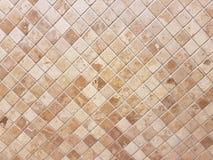La parete delle mattonelle di Brown, marmorizza la parete piastrellata Immagini Stock Libere da Diritti