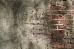 La parete dello stucco con i mattoni ha esposto il fondo Immagini Stock