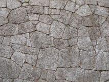 La parete di grandi e pietre ruvide Nei toni caldi Immagine Stock Libera da Diritti