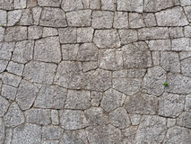 La parete di grandi e pietre ruvide Nei toni caldi Fotografia Stock
