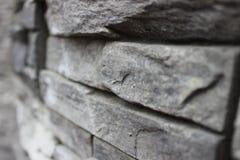 La parete di pietra con gray blocca il primo piano Immagini Stock