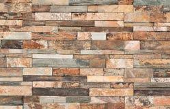 La parete di pietra di Brown piastrella la struttura fotografia stock