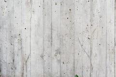 La parete grigia del conrete gradisce il legno Fotografia Stock