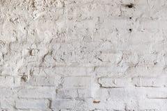 La parete grungy d'annata con il vecchio stucco di pietra ha invecchiato il fondo Fotografie Stock