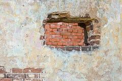 La parete intonacata con un foro Fotografie Stock