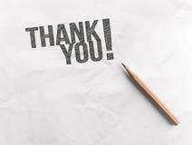 La parola di tiraggio della matita vi ringrazia su carta con lo spazio della copia fotografie stock libere da diritti
