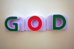La parola DIO in verde e nel colore rosso Fotografia Stock