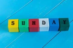 La parola domenica scritta nel colore del bambino di legno Fotografia Stock Libera da Diritti