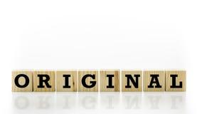 La parola - originale - sui blocchi di legno Fotografia Stock Libera da Diritti