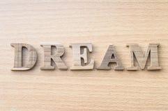 La parola SOGNO dall'alfabeto di legno Fotografia Stock