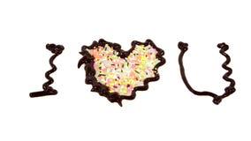 La parola ti amo scritta da cioccolato Immagine Stock