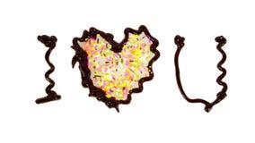 La parola ti amo scritta da cioccolato Fotografie Stock