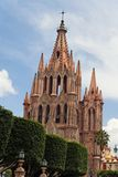 La Parroquia San Miguel Allende. Detail of the neo gothic tower of La Parroquia with its gables and cross in San Miguel Allende, mexican colonial heartland of Royalty Free Stock Photos