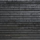 La parte de negro pintó tablones de madera de la pared o de la vertiente del granero fotografía de archivo libre de regalías