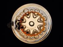 La parte inferiore della tazza di birra di vetro modellato Immagine Stock