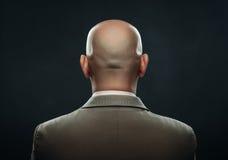 La parte posteriore di un uomo calvo in vestito fotografie stock libere da diritti