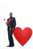 La participation africaine d'homme a monté, présent pour Valentine Day Photographie stock libre de droits