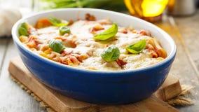 La pasta cuoce Immagini Stock