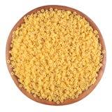 La pasta italiana cruda stars in una ciotola di legno su un bianco Fotografia Stock Libera da Diritti