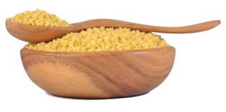 La pasta italiana cruda stars in una ciotola di legno su un bianco Fotografie Stock Libere da Diritti