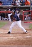 La pastella Jose Coronado di Binghamton Mets guarda un pozzo Fotografia Stock