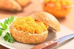 La patata dolce si è sparsa sul panino Fotografia Stock Libera da Diritti