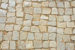 La pavimentazione cobbles il fondo fotografia stock