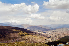 La Paz, Bolivia. A view of La Paz, the capital of Bolivia on a cloudy day with a snow peak mountain in the background royalty free stock photos