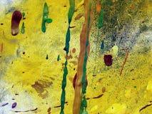La peinture abstraite s'égoutte le jaune Image stock