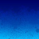 La peinture bleue colorée éclabousse le fond Photos libres de droits