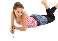 La peinture heureuse de fille/écrivent Photographie stock libre de droits