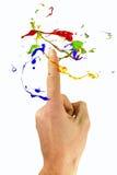 La peinture multicolore font de la lévitation autour de l'index Photographie stock libre de droits