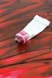 La peinture rouge colorée de l'artiste Image libre de droits